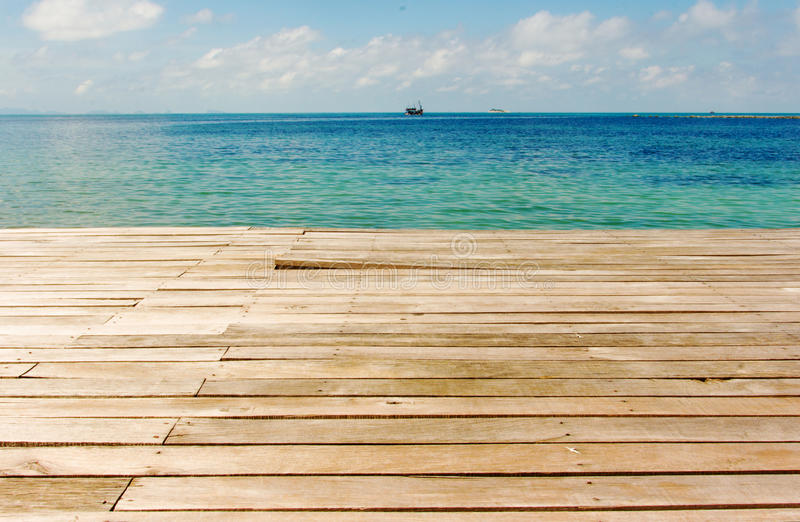 Wooden bridge against blue sea. Wooden bridge blue sea horizon background seascape stock images