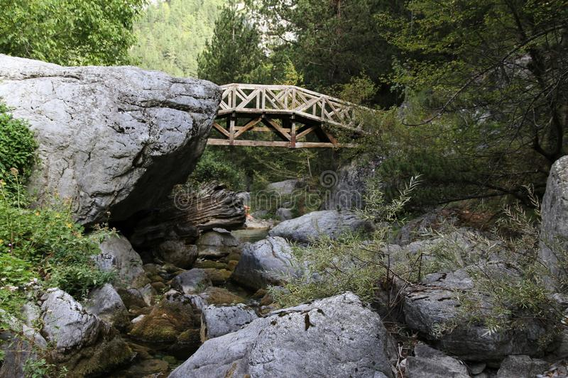 Wooden bridge at the base of Mt. Olympus in Greece. stock photo