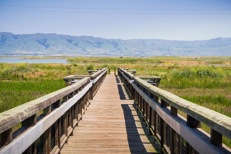 Wooden bridge on the bay trail, Mountain View, Silicon Valley, south San Francisco bay, California stock photography