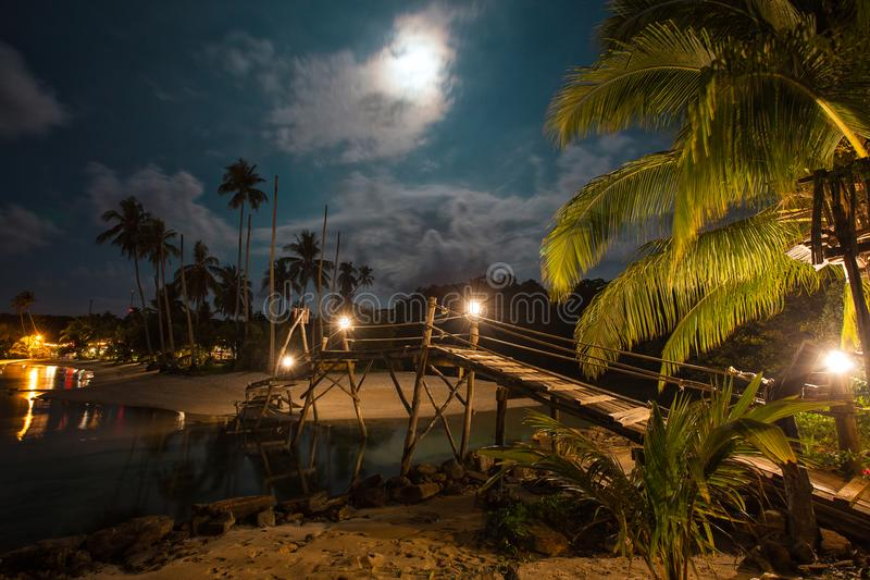 Wooden bridge on the beach at night time. stock image