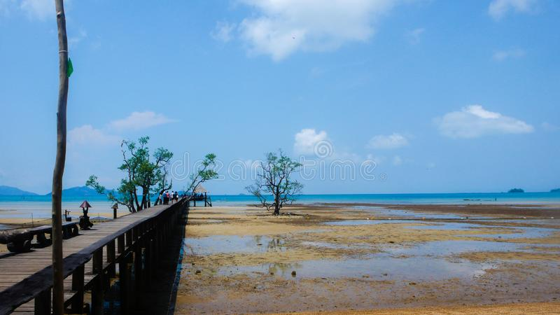 Wooden bridge on the beach royalty free stock photography