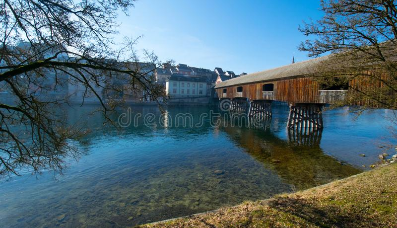 Diessenhofen at the rhine river in Switzerland. The wooden bridge of diessenhofen in Switzerland, crossing the border of Germany and Switzerland stock image