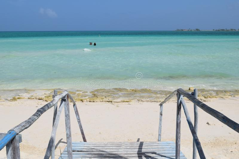 Wooden bridge in a Exotic beach in Cuba. On summer relax take your time excursion stock photography
