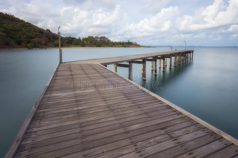 The wooden bridge extending into the sea. Khao Laem Ya National Park, Rayong, Thailand royalty free stock images