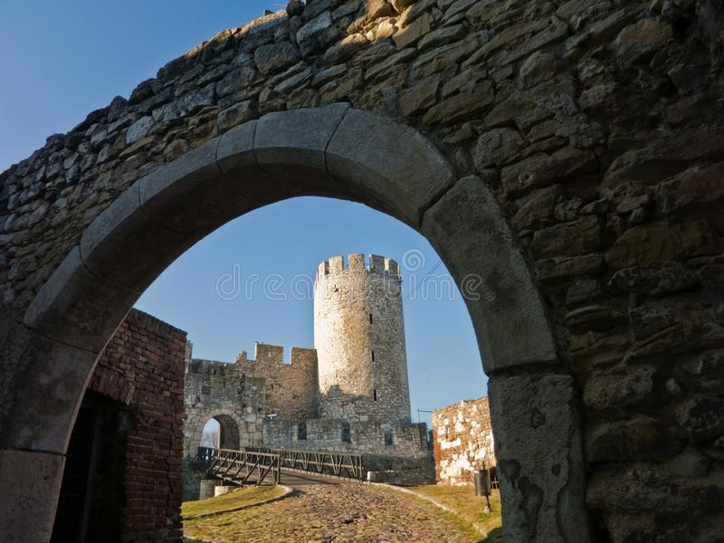 Wooden bridge and gate at the entrance of Kalemegdan fortress on a sunny autumn day in Belgrade royalty free stock photography