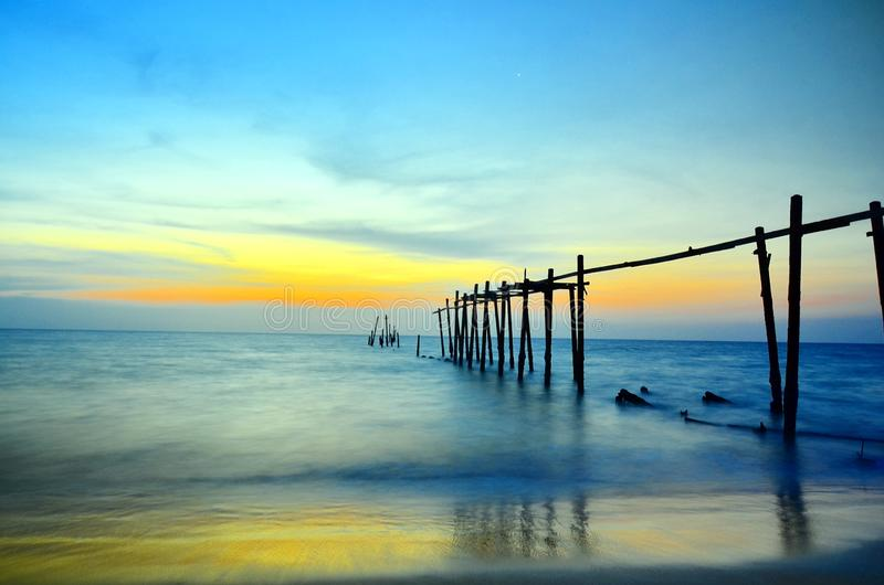 A wooden bridge that has deteriorated over time by a beautiful sunset as a backdrop. Pilai Bridge , Phang-Nga , Thailand. A wooden bridge that has deteriorated stock images