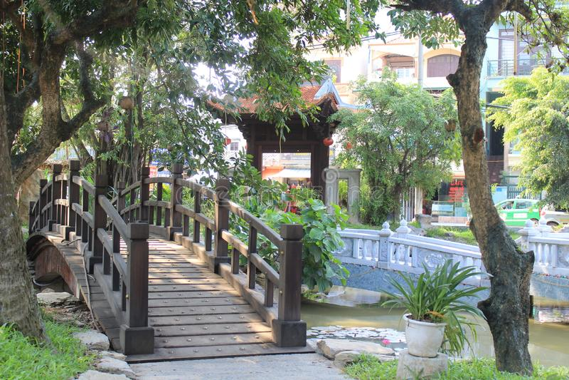 A wooden bridge inside a pogoda stock photo