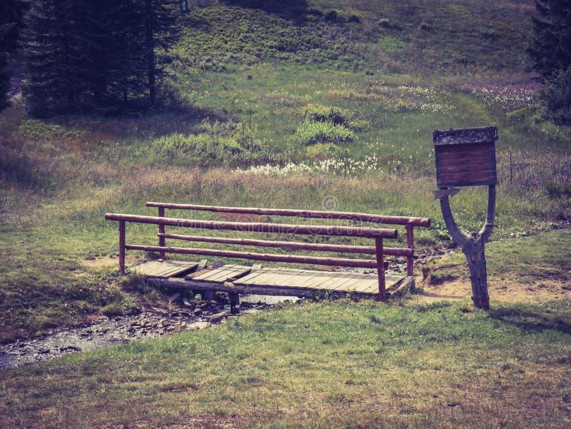 Wooden bridge on a mountain trail stock photo