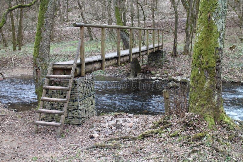 Wooden bridge over brook near Castle of Countess Elisabeth Báthory, Čachtice stock photography