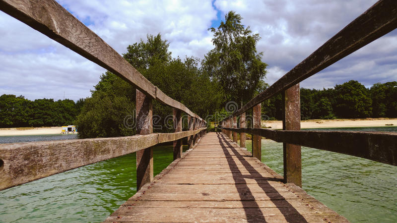 Wooden bridge over a lake stock photography