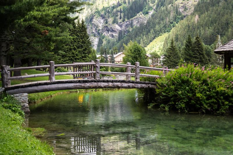 Wooden bridge over the lake in the mountain. View of a wooden bridge over the lake in the mountain during the summertime royalty free stock images
