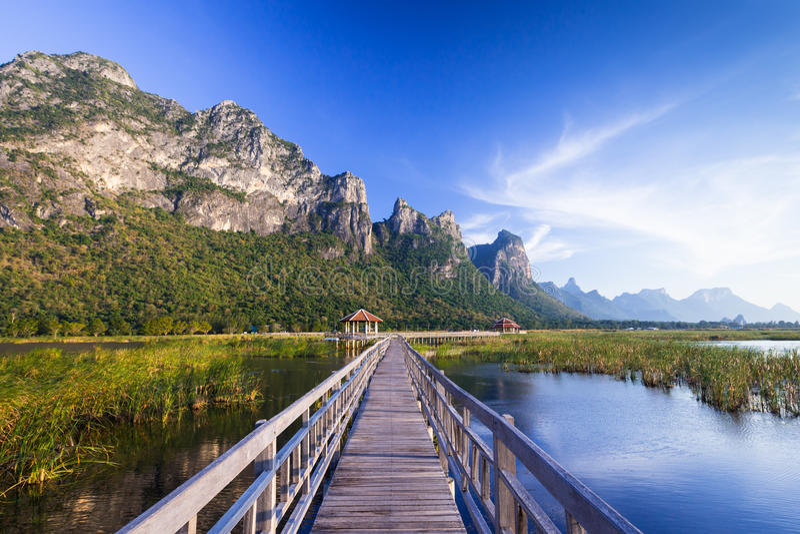 Wooden bridge over a lake in Sam Roi Yod National Park. Prachuap Khiri Khan, Thailand royalty free stock photos