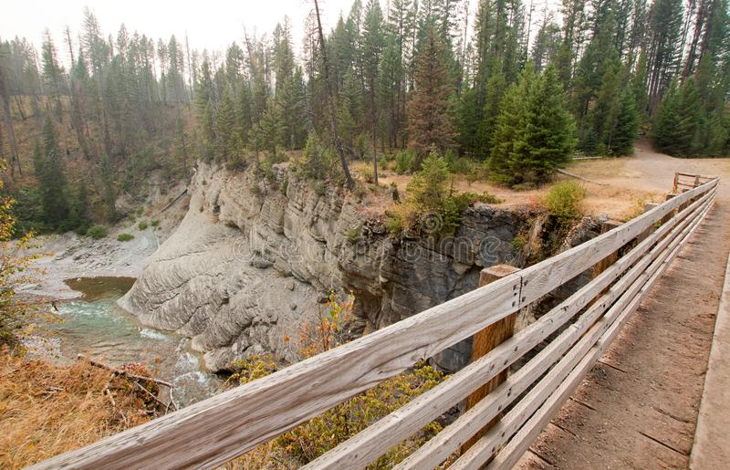 Wooden Bridge over Meadow Creek Gorge for hiking and horseback packing trail in the Bob Marshall Wilderness area in Montana USA. Wooden Bridge over Meadow Creek stock images