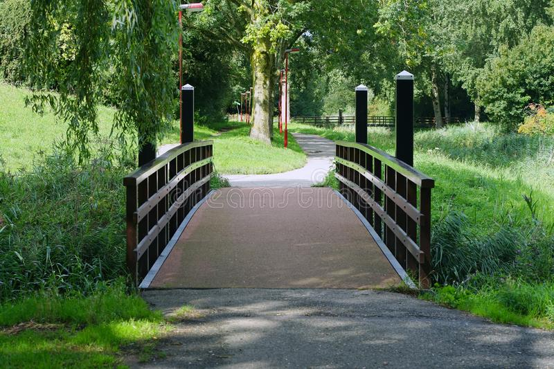 Wooden bridge over a pond royalty free stock photo