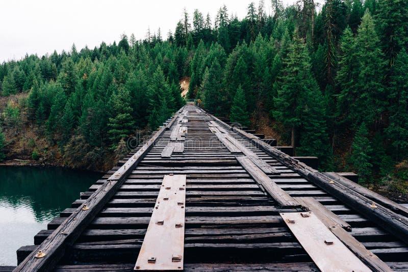 Wooden bridge over river royalty free stock photos
