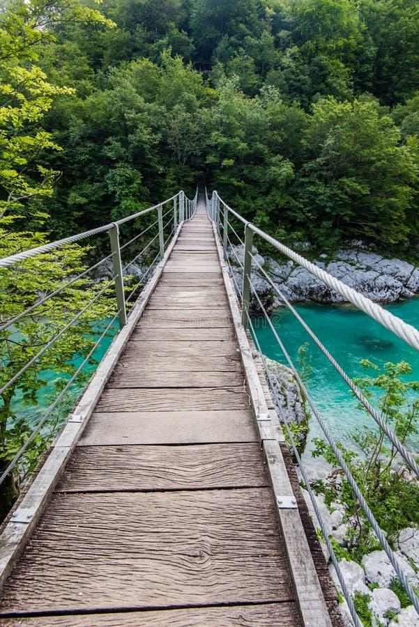 Wooden Bridge over rover Soca, Slovenia. In Julian Alps stock photos