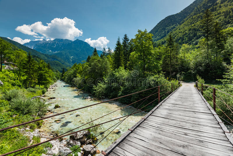 Wooden bridge over Soca river in Slovenia.  royalty free stock images