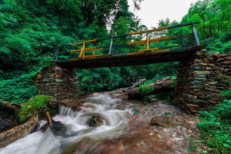 Wooden bridge over waterfall in himalayas - sainj, kullu, himachal, India. Photo of wooden bridge over waterfall in himalayas - sainj, kullu, himachal, India stock photos