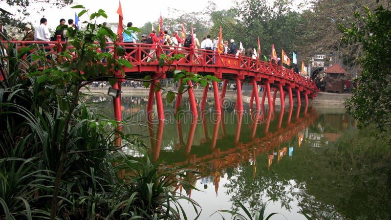 Wooden Bridge Overlaying Lake Surface royalty free stock photo