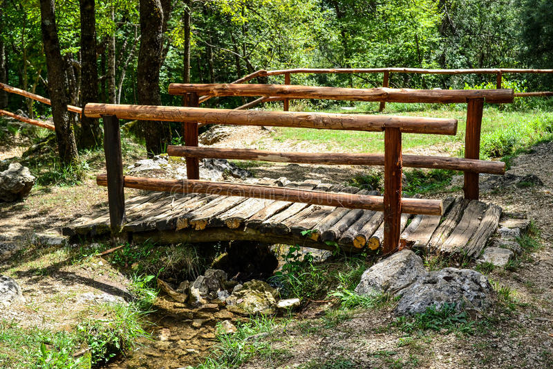 Wooden bridge in the park stock images