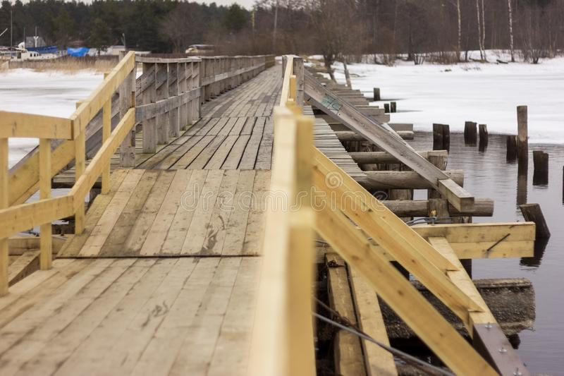 Wooden bridge in town of Priozersk at Vuoksa river royalty free stock photography