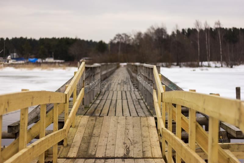 Wooden bridge in town of Priozersk at Vuoksa river stock photography