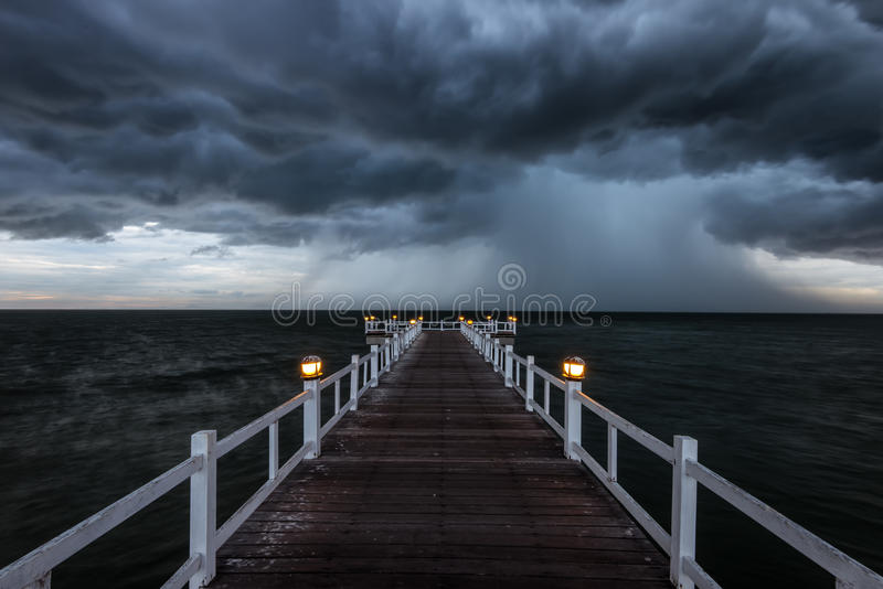 Wooden bridge into the sea Thailand stock photography