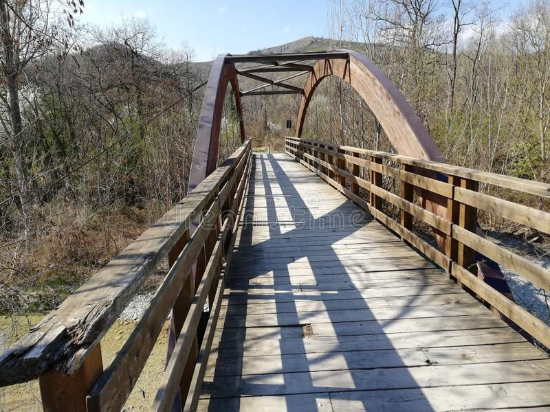 A wooden bridge with a semicircular wooden vault stock images