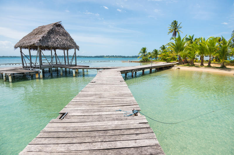 Wooden bridge with small hut on Bocas del Toro stock photography