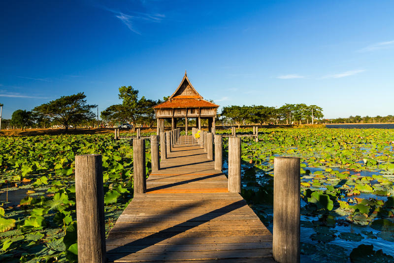 Wooden bridge at Thai wooden temple architecture on Park NongKhu in UbonRatchathani province, Thailand. Wooden bridge at Thai wooden temple architecture on Park stock photo