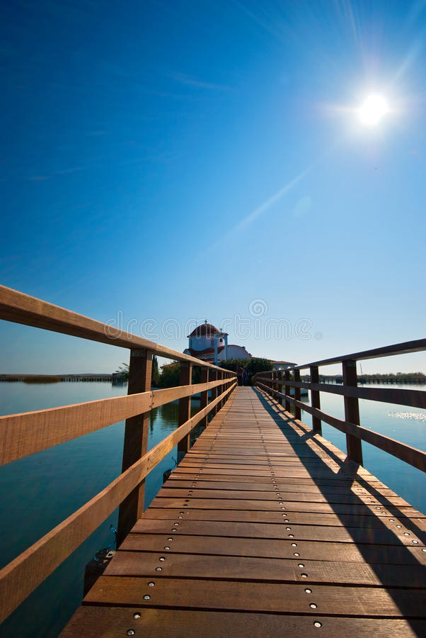 Wooden Bridge To An Island Church Royalty Free Stock Photo