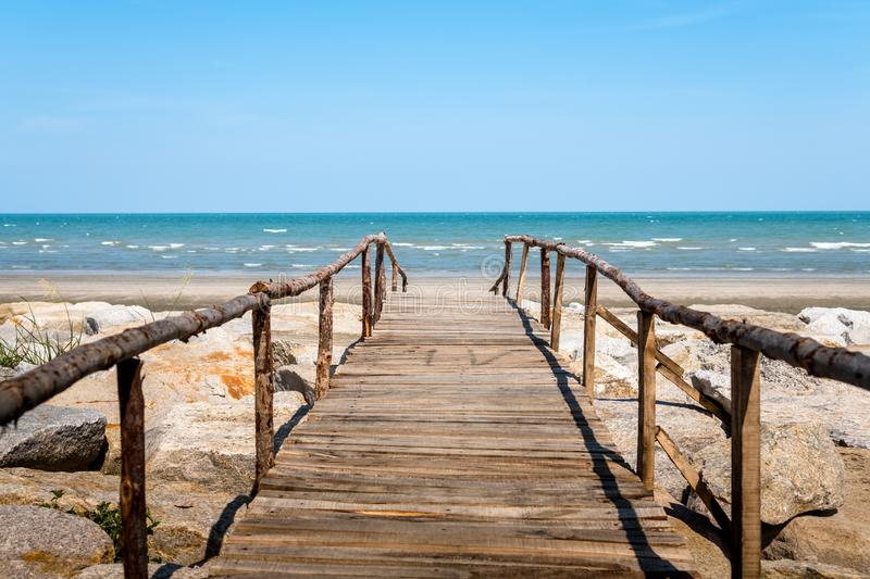 Wooden bridge walkway to the sea beach. On blue sky background beautiful beauty calm cloud coast day holiday horizon landscape nature ocean outdoor sand royalty free stock photos