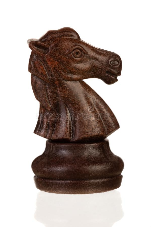 Wooden brown chess piece. Isolated on white background stock photos