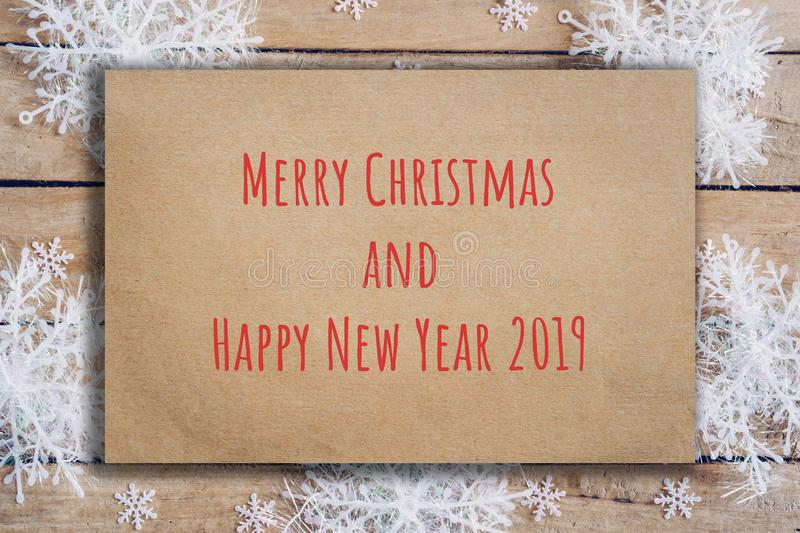 Wooden brown christmas background with snowflakes and old brown paper text from Merry christmas and Happy new year 2019 royalty free stock photography