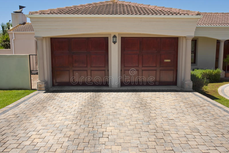 Wooden brown double garage doors stock photo