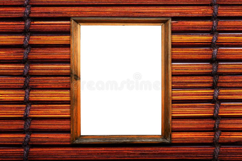 Wooden brown frame on bamboo mat royalty free stock images