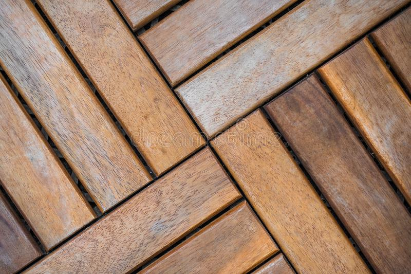 Wooden brown planks on the floor as a deatiled background pattern. Wooden brown tiles on the floor as a deatiled background pattern parquet texture natural old stock photography