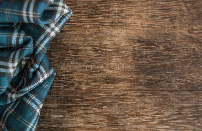 Wooden brown table with mint napkin in to the blue cell royalty free stock photo