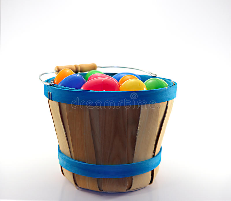 Wooden Bucket full of assorted easter eggs stock photo