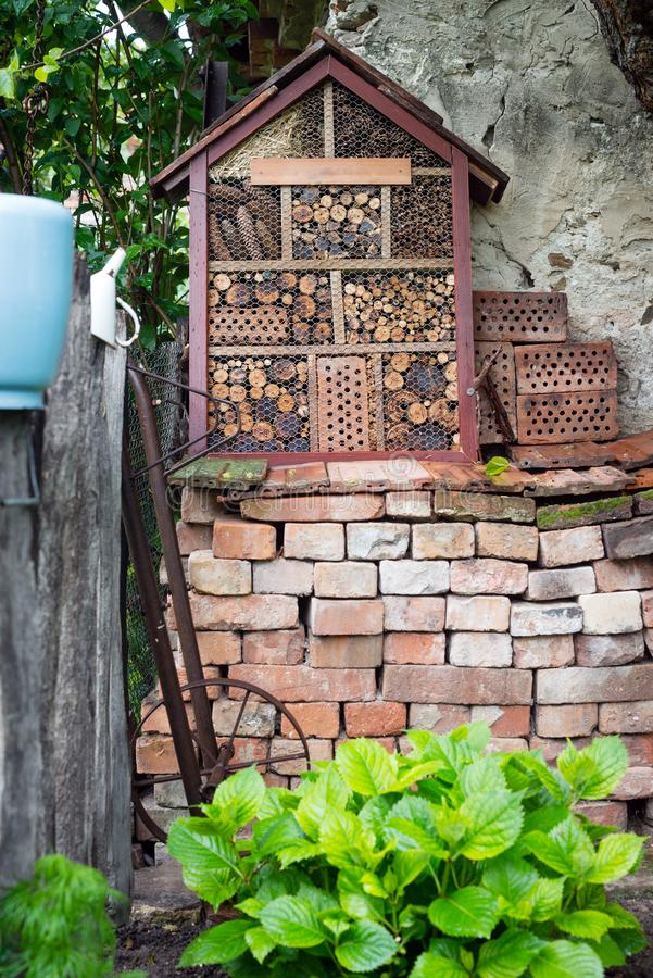 Wooden bug house in garden. A nice wooden bug house in the garden royalty free stock image