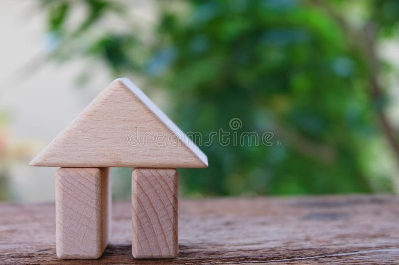 Wooden building block in house shape. Backdrop for property investment, house mortgage, room rent and home loan royalty free stock image