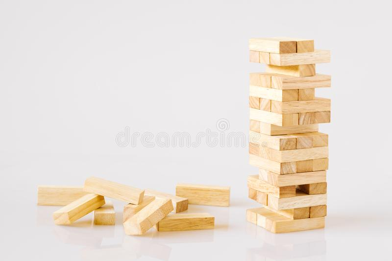 Wooden building blocks tower isolated on white background with c stock images