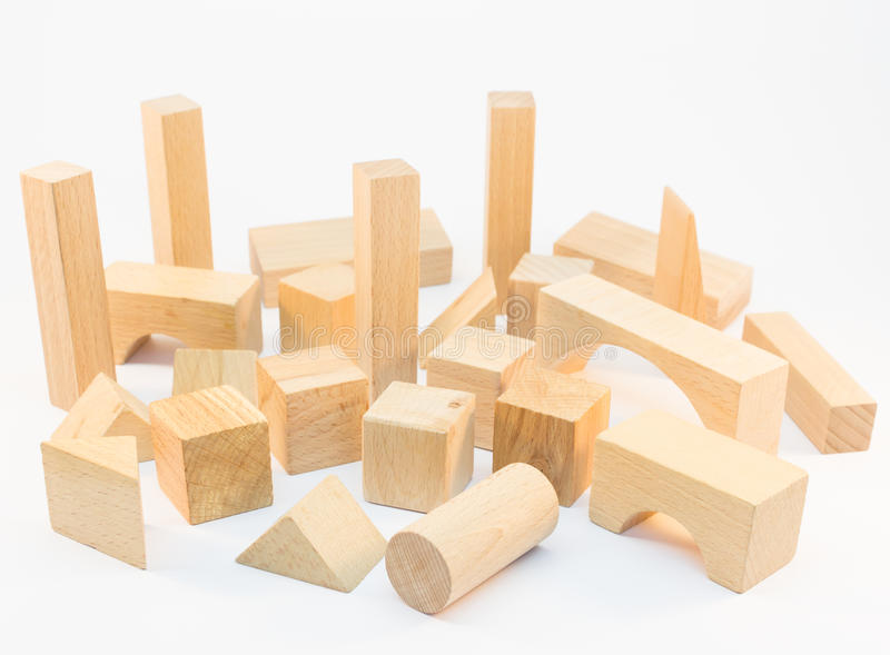 Wooden building blocks on white background royalty free stock image