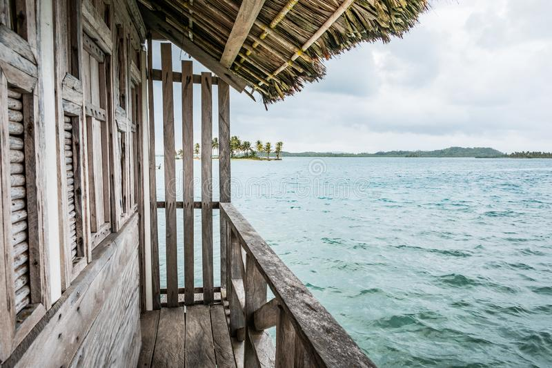 Wooden bungalow with ocean view , wood hut. With tropical island background stock photos