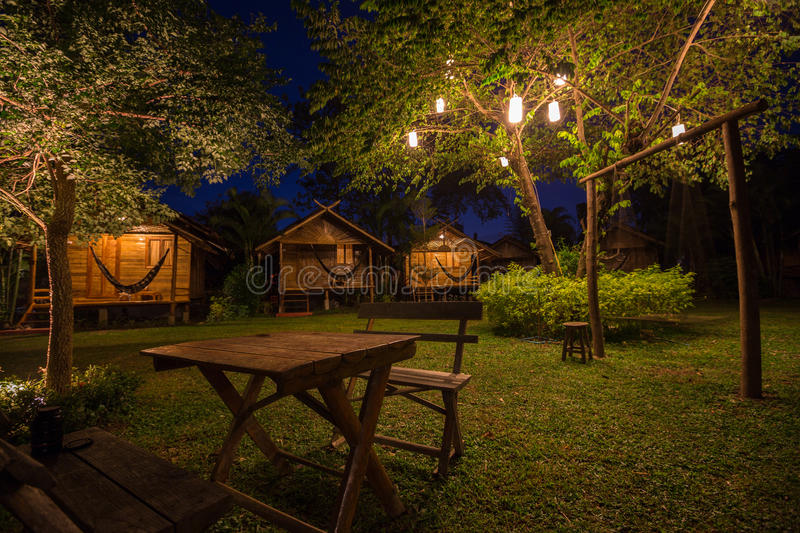 Wooden bungalows at night stock photo