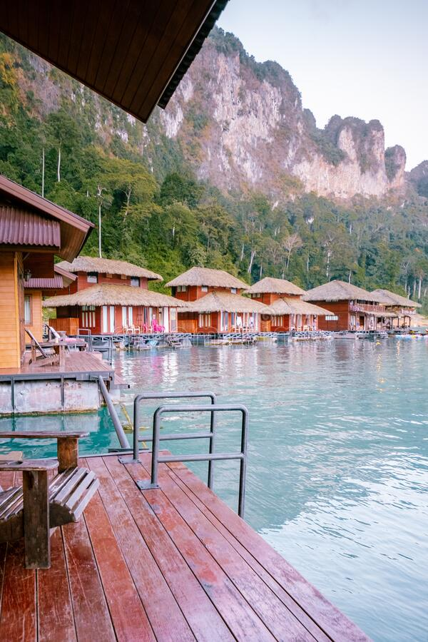 Wooden bungalows on tropical shore in the Chiew Lan Lake, Khao Sok national park, Thailand. Lake royalty free stock photo