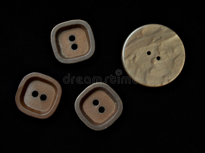 Wooden buttons. Assorted buttons on black background stock image