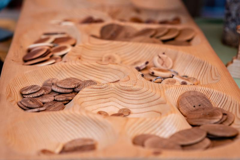 Wooden buttons and keychains in the souvenir shop. Wooden buttons and keychains in the souvenir shop royalty free stock image