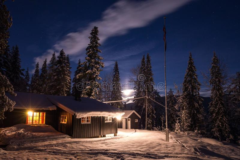 Wooden cabin in the woods near Heia, Geitfjellet, northern Norway. Beautiful winter night royalty free stock images