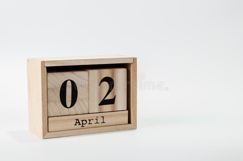 Wooden calendar April 02 on a white background stock photography